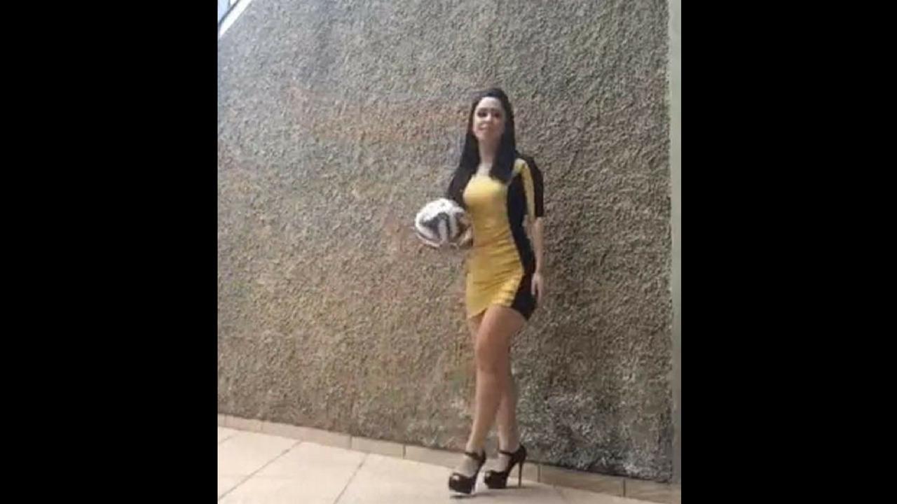 girl on heels with football