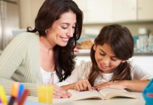 mother-teaching-daughter-reading
