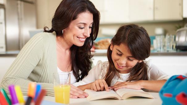 mother-teaching-daughter-reading