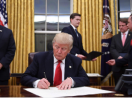 donald trump signs first order trump signs the order for imposing limitations on H1B visa