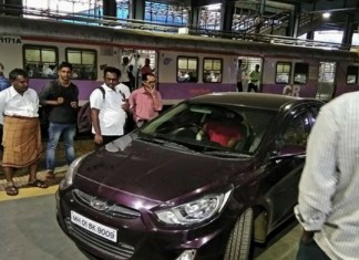 cricket player drove car in railway platform