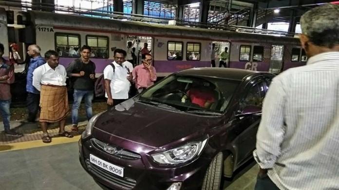 cricket player drove car in railway platform
