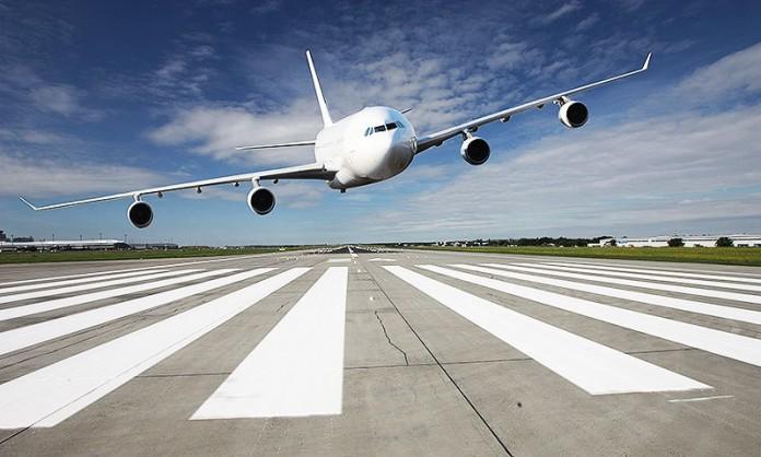 pakistan-airline passenger tries to open airplane door