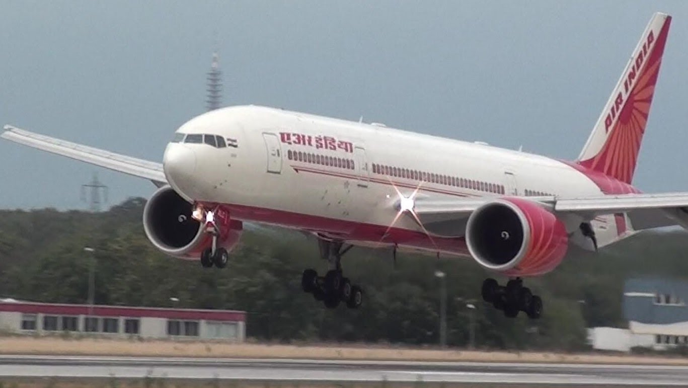 air india kochi jidha airplane damaged passengers as a protest sat inside demanding parallel arrangement