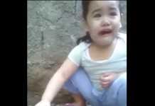 Girl crying over a dead chicken