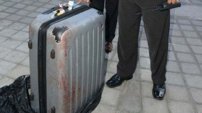 girl corpse found in suitcase