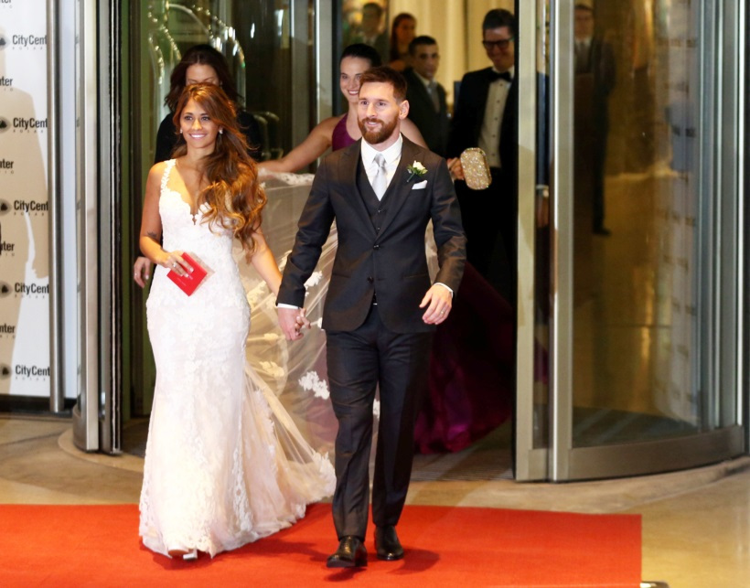 Argentine soccer player Lionel Messi and his wife Antonela Roccuzzo make an appearance for the press at their wedding in Rosario