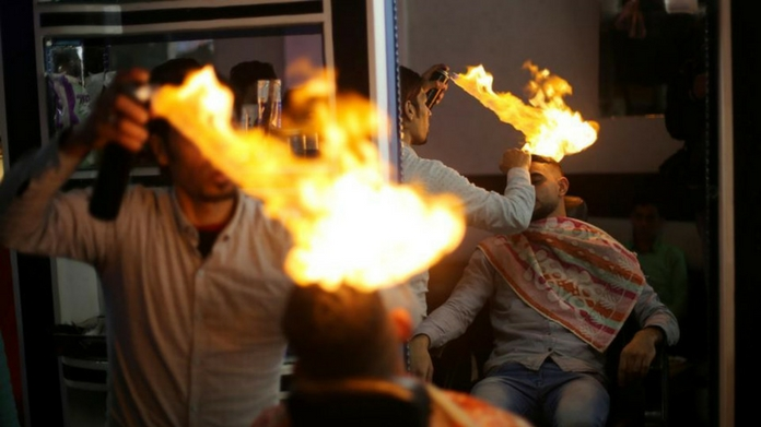 mumbai salon uses fire for hair cutting