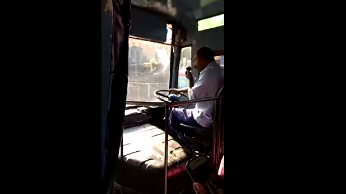 KSRTC driver repairs mobile while driving video