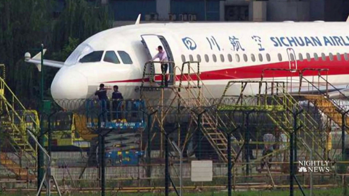 Sichuan Airlines co-pilot sucked halfway out cockpit window