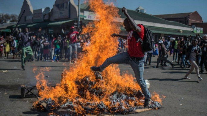 At least 3 killed after Zimbabwe troops fire upon protesters