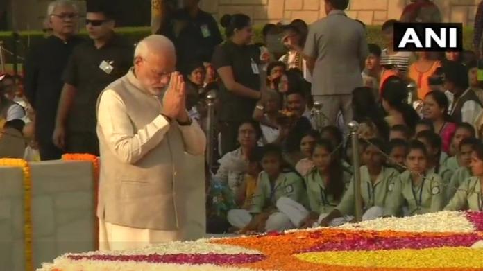 narendra modi pays tribute to mahatma gandhi at rajghat