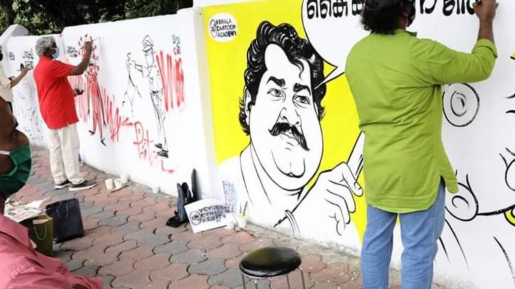 Kottayam Cartoon Wall With covid awareness Message