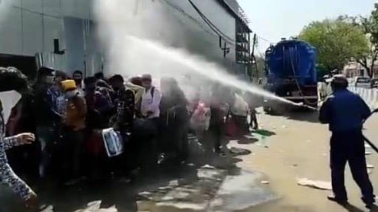 delhi disinfectant sprayed on migrant workers