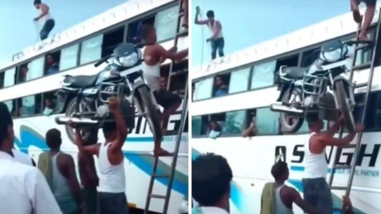 Man climbs ladder with a bike on his head video goes viral