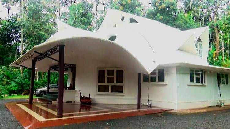 low cost house with Areca palm