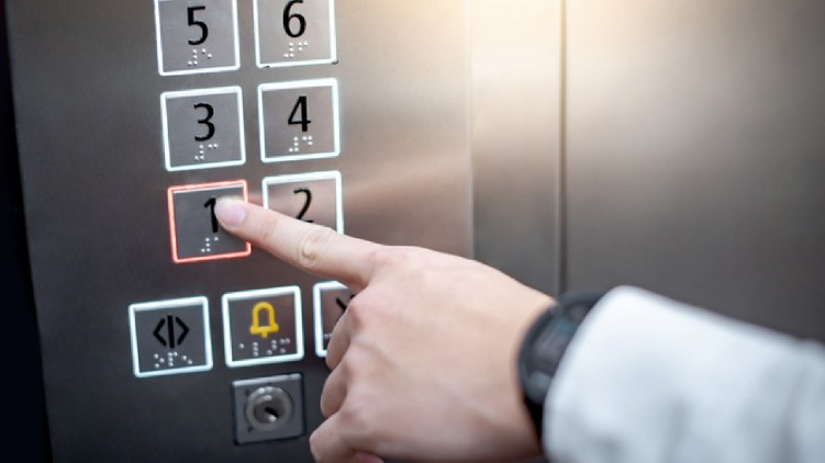 Woman COVID-19 Elevator