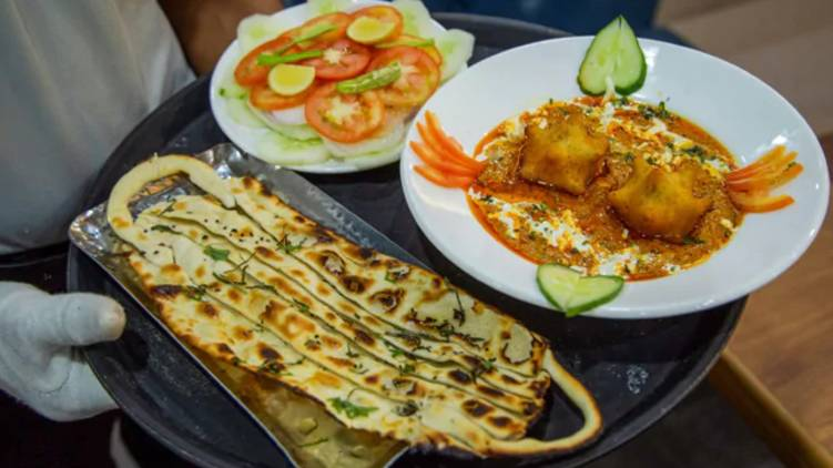 hotel distribute covid curry and mask naan