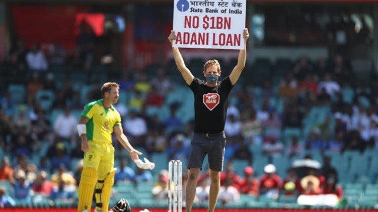 Protesters ground banner Adani