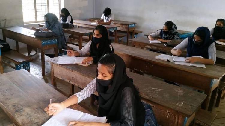 school covid guidelines tightens