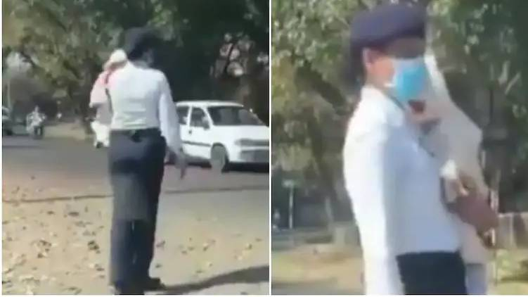 cop controls traffic with baby in her arms viral video