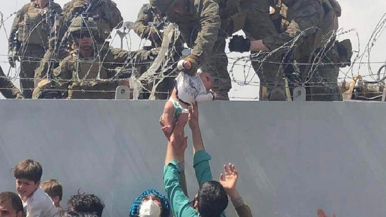 Afghan Baby Reunited With Father