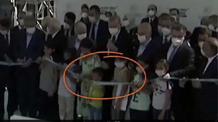 Boy Cuts Ribbon Turkish